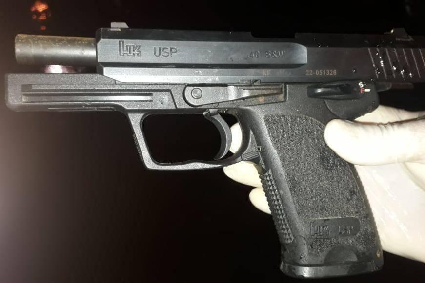 Arma apreendida com os criminosos