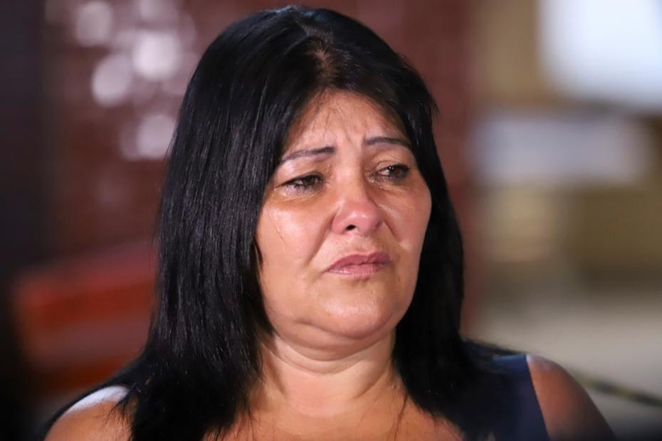 9084adfba402f Mãe de desaparecido após rompimento de barragem espera notícias no ...