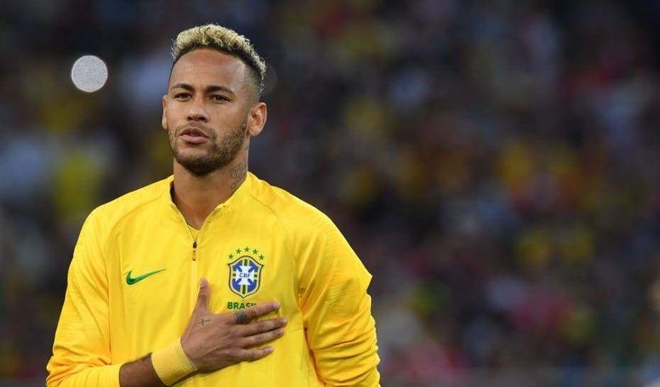 707526411f7 Brazil s forward Neymar sings the national anthem during the Russia 2018  World Cup Group E football match between Serbia and Brazil at the Spartak  Stadium ...